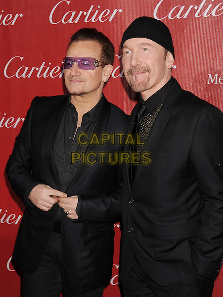 PALM SPRINGS, CA- JANUARY 04: Musicians Bono (L) and The Edge of U2 arrive at the 25th Annual Palm Springs International Film Festival Awards Gala at Palm Springs Convention Center on January 4, 2014 in Palm Springs, California.<br /> CAP/ROT/TM<br /> &copy;Tony Michaels/Roth Stock/Capital Pictures