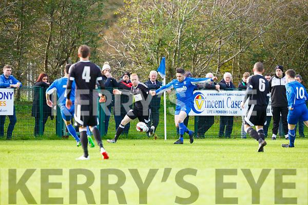 Eanna Killarney Athletic clears the ball against Janesboro in Woodlawn on Sunday