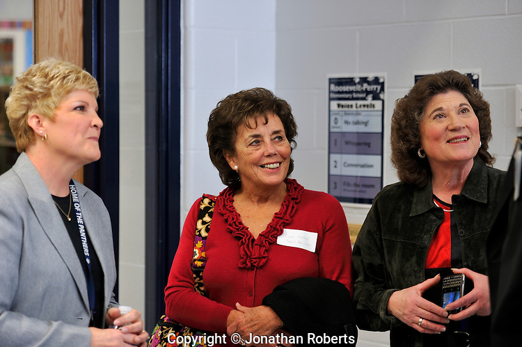 Board Members Carol Ann Haddad, center, and Linda Duncan, far right, with Principal Pam Howell..Roosevelt-Perry Elementary School celebrates the opening of its technology wing.