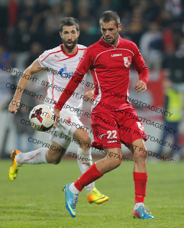 Fudbal Super liga season 2013-2014<br /> Radnicki Nis v Crvena Zvezda<br /> Ivica Jovanovic (R) and Nikola Mijailovic<br /> Nis, 26.10.2013.<br /> foto: Srdjan Stevanovic/Starsportphoto &copy;