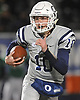 Tommy Heuer #10, Oceanside quarterback, runs the ball on a keep during the Nassau County Conference I varsity football semifinals against Farmingdale at Hofstra University on Saturday, Nov. 11, 2017.