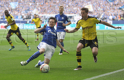 10.04.2016. Gelsenkirchen, Germany.  Schalke's Sascha Riether (L) in action against Dortmund's Erik Durm during the German Bundesliga  match between FC Schalke 04 and Borussia Dortmund at the Veltins Arena in Gelsenkirchen, Germany, 10 April 2016.