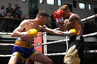 Neal Parry (blue/gold shorts) defeats Fonz Alexander during a Boxing Show at York Hall on 8th June 2019