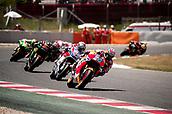 June 11th 2017, Barcelona Circuit, Montmelo, Catalunya, Spain; MotoGP Grand Prix of Catalunya, Race Day; Dani Pedrosa of the Repsol Honda Motogp Team leads; Andrea Dovizioso;  of the Ducati Motogp Team and Jonas Folger of the Monster Yamaha Tech 3 Motogp Team during the Motogp race
