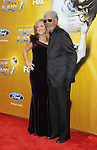LOS ANGELES, CA. - February 26: Producer Lori McCreary and actor Morgan Freeman (L-R) arrive at the 41st NAACP Image Awards at The Shrine Auditorium on February 26, 2010 in Los Angeles, California.