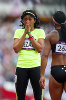 03 AUG 2012 - LONDON, GBR - Hala Gezah (LBA) of  Libya watches the monitor after her women's 100m heat during the London 2012 Olympic Games athletics at the Olympic Stadium in the Olympic Park in Stratford, London, Great Britain (PHOTO (C) 2012 NIGEL FARROW)