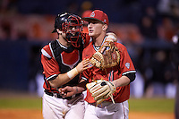 Ball State Cardinals catcher Jarett Rindfleisch (25) and starting pitcher Zach Plesac (11) walk to the dugout during a game against the Wisconsin-Milwaukee Panthers on February 26, 2016 at Chain of Lakes Stadium in Winter Haven, Florida.  Ball State defeated Wisconsin-Milwaukee 11-5.  (Mike Janes/Four Seam Images)
