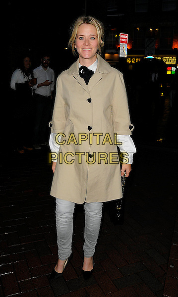 EDITH BOWMAN .At the Huggies Little Bundle Of Laughs gala evening, Leicester Square Theatre, London, England, UK, .10th August 2010..full length grey gray jeans denim beige mac trench coat white shirt tie black heart buttons shoes .CAP/CAN.©Can Nguyen/Capital Pictures.