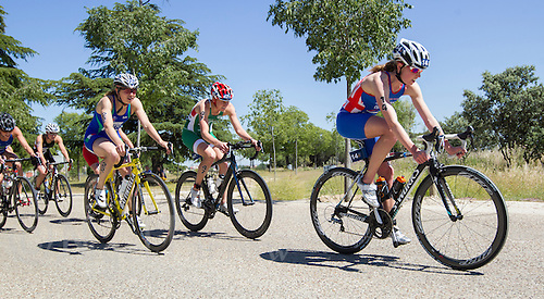 01 JUN 2013 - MADRID, ESP - Non Stanford  (GBR) (right) of Great Britain leads the second pack during the bike at the elite women's ITU 2013 World Triathlon Series round in Casa de Campo, Madrid, Spain <br /> (PHOTO (C) 2013 NIGEL FARROW)