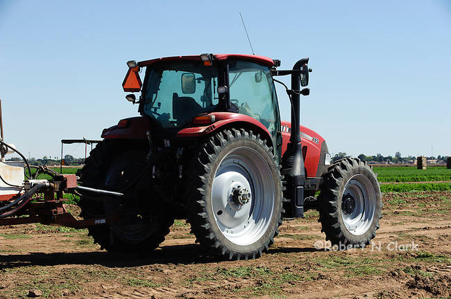Case tractor in a harvested carrot field