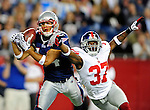 New England's Robert Ortiz, left, hauls in a third quarter touchdown over Giants' Bruce Johnson on Thursday,  September 03, 2009.  Photo by Christopher Evans saved in Friday