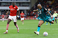 Andre Ayew of Swansea City (R) takes a shot during the Sky Bet Championship match between Barnsley and Swansea City at Oakwell Stadium, Barnsley, England, UK. Saturday 19 October 2019