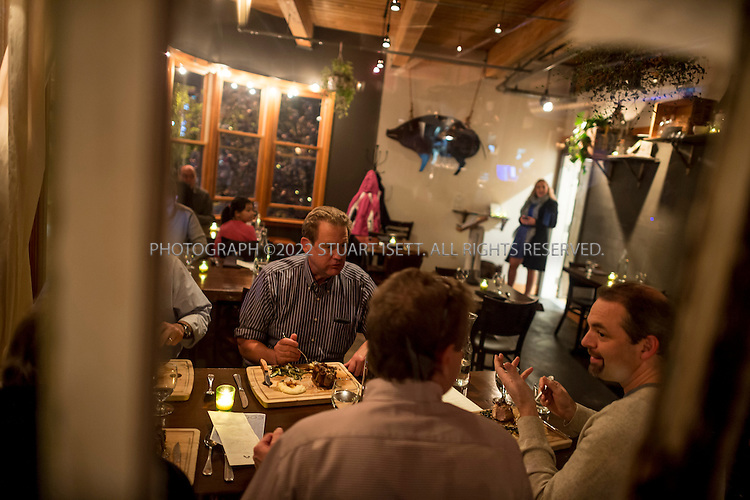 10/16/2014&mdash;Seattle, WA, USA<br /> <br /> Derek Ronspies, owner and chef at Le Petit Cochon in Seattle&rsquo;s Fremont neighborhood. Here customers enjoy dinner.<br /> <br /> Photograph by Stuart Isett<br /> &copy;2014 Stuart Isett. All rights reserved.