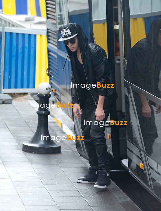 """EXCLUSIVE PHOTOS - Justin Bieber touring in Belgium - Justin Bieber arrived from France in Belgium-Brussels,  on April 9th at 4 am with his black/grey touring bus """"  Beat the street """"..He checked into the  """" Steigenberger """"  hotel in Brussels. A few hours later, his fans were surrounding the front and back entrance of his hotel, that the security of the hotel could not handle such a craziness and had to get some big help from the brussels police. About 40 police officers arrived to surround the hotel to protect the star who had two concerts in the city of Antwerp. But Justin asked the police to leave, which they did after a while!! Justin kept hiding in the hotel between the fitness center kept opened only for him, as well the swimming pool where he did some water polo with his musicians. The bar of the hotel even got closed to the guests of the hotel around 6pm, to let justin enjoying the bar. On the first day of his concert, Justin escaped his fans by jumping from his Mercedes van into his tour bus, hided by his bodyguards. Justin's musicians even played the piano at the piano bar  of the hotel, singing Elton John's songs! It's only on his 3rd and last day in Brussels  ( April11th ) that Justin Bieber finally agreed to meet with his fans on the street. Brussels, April 10th & 11th, 2013."""