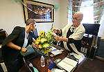 Nevada Sen. Debbie Smith, D-Sparks, and her daughter Erin Marlon look through gifts left in her office at the Legislature, in Carson City, Nev., on Wednesday, April 8, 2015. Smith returned to work Wednesday, two months after having a malignant brain tumor removed. (Cathleen Allison/Las Vegas Review-Journal)