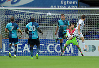 Matt McClure of Aldershot Town scores his side's 2nd goal despite the effort from Will De Havilland  of Wycombe Wanderers to head it off the line during the Friendly match between Aldershot Town and Wycombe Wanderers at the EBB Stadium, Aldershot, England on 26 July 2016. Photo by Alan  Stanford.