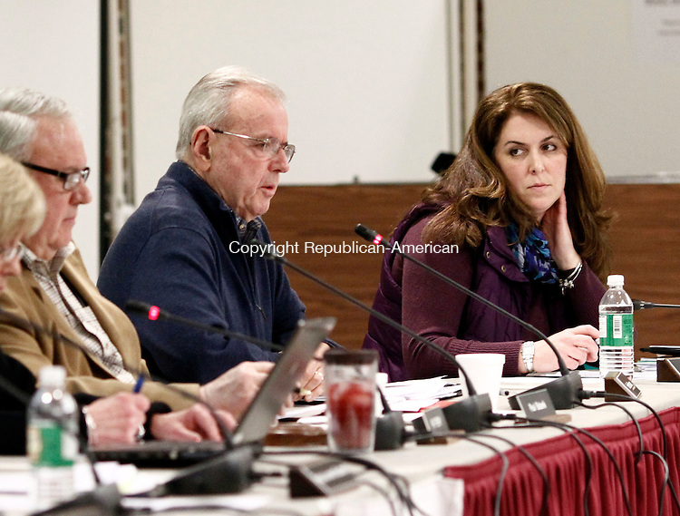 Southbury, CT- 07 April 2014-040714CM05-  Pomperaug Region School District 15 board of education member, Jennifer Connelly, right, listens in as fellow member Fran Brennan addresses members of the community during a public hearing on its proposed budget at Pomperaug High School in Southbury on Monday.  Christopher Massa Republican-American
