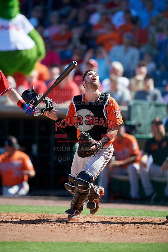 Baltimore Orioles catcher Austin Wynns (61) tracks a pop up during a Grapefruit League Spring Training game against the Philadelphia Phillies on February 28, 2019 at Spectrum Field in Clearwater, Florida.  Orioles tied the Phillies 5-5.  (Mike Janes/Four Seam Images)