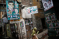 A girl walks in the old part of Lahore decorated with pre-election posters May 10, 2013. Pakistan's general elections will be held on May 11.   REUTERS/Damir Sagolj (PAKISTAN)