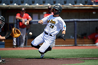 West Virginia Black Bears Brendt Citta (28) slides home during a NY-Penn League game against the Batavia Muckdogs on August 29, 2019 at Monongalia County Ballpark in Morgantown, New York.  West Virginia defeated Batavia 5-4 in ten innings.  (Mike Janes/Four Seam Images)