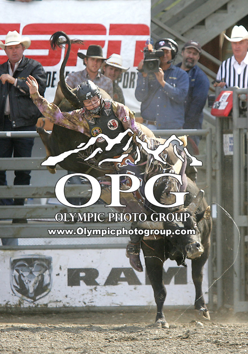 29 Aug 2010:  Kanin Asay was not able to score while riding the bull Juicy Vindication during the second round of the Seminole Hard Rock Extreme Bulls competition at the Kitsap County Stampede in Bremerton, Washington.
