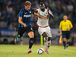 Davide Santon of FC Internazionale Milano (L) competes for the ball with M«Baye Niang of AC Milan during the AC Milan vs FC Internacionale as part of the International Champions Cup 2015 at the looks onnggang Stadium on July 25, 2015 in Shenzhen, China.  Photo by Aitor Alcalde / Power Sport Images