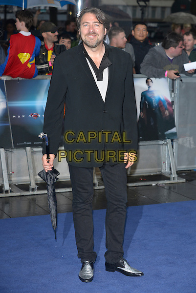 Jonathan Ross<br /> 'Man Of Steel' UK film premiere, Empire cinema, Leicester Square, London, England. <br /> 12th June 2013<br /> full length black suit umbrella <br /> CAP/PL<br /> &copy;Phil Loftus/Capital Pictures