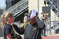 University of Missouri head track and field coach Rick Mcguire talks with freshman Leslie Farmer at the Jefferson Cup track meet at Audrey Walton Stadium, in Columbia, MO. Saturday, April 4, 2009.
