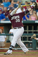 Mississippi State first baseman Wes Rea (35) follows through on his swing against the Indiana Hoosiers during Game 6 of the 2013 Men's College World Series on June 17, 2013 at TD Ameritrade Park in Omaha, Nebraska. The Bulldogs defeated Hoosiers 5-4. (Andrew Woolley/Four Seam Images)