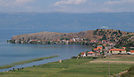 Lin-Pogradec-Albania - August 02, 2004---Partial view of the village / peninsula of Lin and Lake Ohrid (wih Macedonian mountains and shore at the horizon); region/village of project implementation by GTZ-Wiram-Albania (German Technical Cooperation, Deutsche Gesellschaft fuer Technische Zusammenarbeit (GTZ) GmbH); landscape-nature---Photo: Horst Wagner/eup-images