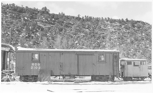 RGS outfit car #2102 with a Fairmont section car on the siding in Dolores.<br /> RGS  Dolores, CO  Taken by Peyton, Ernie S. - 3/28/1950