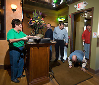 David Bruns kneels to kiss the floor as he enters with friends as the first customers to buy beer at Old Bag of Nails restaurant and bar in downtown Westerville, Ohio, Thursday, February 23, 2006. The business occupies a building at the main crossroads in the city that was home to the Anti-Saloon League. Alcohol was last served in the city more than 120 years ago...<br />