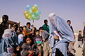 Khair Khan, Afghanistan<br /> November 29, 2001<br /> <br /> The distribution of USA wheat, oil and lentils by World Food Program to 130 families at the Ghulam Haidar Khan High School.