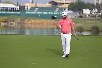 Andy Sullivan (ENG) sinks his putt on the 14th green during Thursday's Round 1 of the 2016 Portugal Masters held at the Oceanico Victoria Golf Course, Vilamoura, Algarve, Portugal. 19th October 2016.<br /> Picture: Eoin Clarke | Golffile<br /> <br /> <br /> All photos usage must carry mandatory copyright credit (&copy; Golffile | Eoin Clarke)