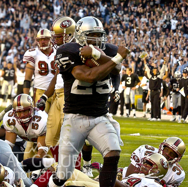 Oakland Raiders running back Charlie Garner (25) celebrates touchdown on Sunday, November 3, 2002, in Oakland, California. The 49ers defeated the Raiders 23-20 in an overtime game.