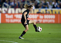 Heather O'Reilly (9) of the USWNT takes a touch on the ball at the top of the box during the game at WakeMed Soccer Park in Cary, NC.   The USWNT defeated Japan, 2-0..