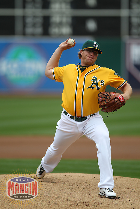 OAKLAND, CA - AUGUST 4:  A.J. Griffin #64 of the Oakland Athletics pitches against the Toronto Blue Jays during the game at O.co Coliseum on Saturday, August 4, 2012 in Oakland, California. Photo by Brad Mangin