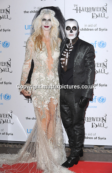 NON EXCLUSIVE PICTURE: PAUL TREADWAY / MATRIXPICTURES.CO.UK<br /> PLEASE CREDIT ALL USES<br /> <br /> WORLD RIGHTS<br /> <br /> American fashion designer Melissa Odabash and Welsh designer Julien Macdonald OBE attending the UNICEF Halloween Ball at London's One Mayfair.<br /> <br /> OCTOBER 31st 2013<br /> <br /> REF: PTY 137081