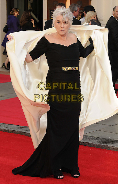 Tyne Daly.The Olivier Awards 2012, Royal Opera House, Covent Garden, London, England..April 15th, 2012.full length dress black white jacket coat taking off removing gesture .CAP/CAN.©Can Nguyen/Capital Pictures.