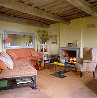 The inspiration for the colour scheme of the living room was the earth tones of the local Tuscan countryside