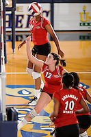 20 November 2008:  Arkansas State setter Laura Bennett (12) keeps the ball in play during the Middle Tennessee 3-0 victory over Arkansas State in the first round of the Sun Belt Conference Championship tournament at FIU Stadium in Miami, Florida.