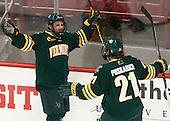 Jonathan Turk (UVM - 8), Mario Puskarich (UVM - 21) - The visiting University of Vermont Catamounts defeated the Northeastern University Huskies 6-2 on Saturday, October 11, 2014, at Matthews Arena in Boston, Massachusetts.