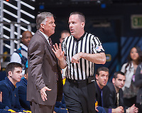 California's head coach Mike Montgomery listens to the referee during a game at Haas Pavilion in Berkeley, California on March 8th, 2014. California defeated Colorado 66 - 65