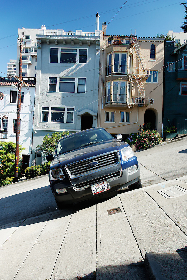 Ford SUV parked on Filbert Street's steep hill, San Francisco, California, USA, North America