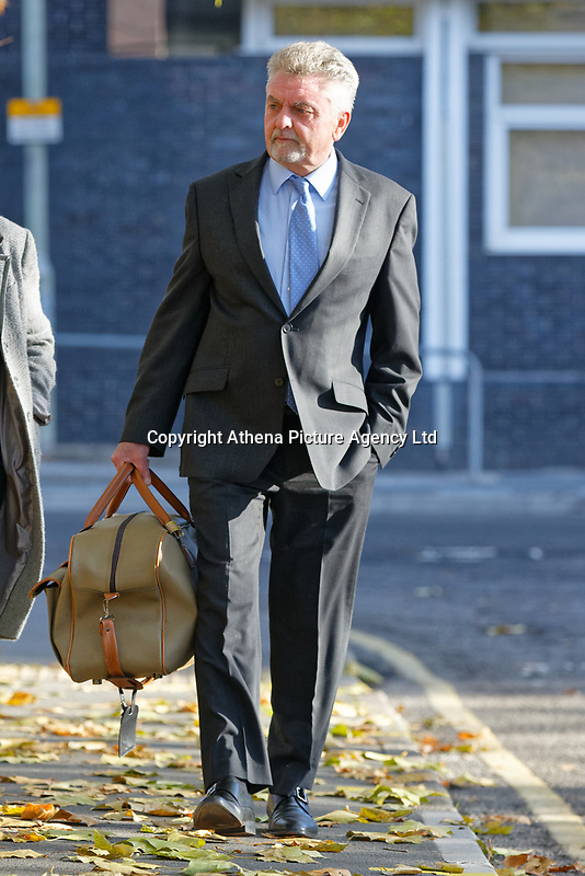 Pictured: Robert Howells arrives at Merthyr Crown Court, south Wales, UK. Friday 02 November 2018<br /> Re: Three men who defrauded the NHS are due to be sentenced at Merthyr Crown Court, Wales, UK.<br /> Michael Cope, 42, had denied ensuring building contracts were awarded to a rotten company while working for Powys Teaching Health Board in 2015.<br /> His colleagues Mark Evill and Robert Howells previously pleaded guilty to the fraud, which cost taxpayers £1.4m to put right.<br /> Cope claimed he knew nothing about the scam but was convicted at Merthyr Tydfil Crown Court..<br /> Together, they awarded construction contracts to a company Evill set up called George Morgan Limited.<br /> The court was told the work carried out by the firm was so poor it cost £1.4m to fix.<br /> Evill spent the company's profits on holidays to Dubai, expensive watches, property, and cars, including a vehicle for Howells for helping him.<br /> To hide his involvement in the scam, Evill used the names Paul Hewson and David Evans in emails - the real names of Bono and The Edge from U2.