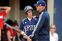 11 February 2012:  FIU's Jessy Alfonso (8) speaks with Head Coach Jake Schumann as the University of Louisville Cardinals defeated the FIU Golden Panthers, 4-2, as part of the COMBAT Classic at the FIU Softball Complex in Miami, Florida.