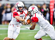 Baltimore, MD - OCT 14, 2017: Richmond Spiders quarterback Kyle Lauletta (5) hands the ball off to Richmond Spiders running back Xavier Goodall (2) during game between Towson and Richmond at Johnny Unitas Stadium in Baltimore, MD. The Spiders defeated the Tigers 23-3. (Photo by Phil Peters/Media Images International)