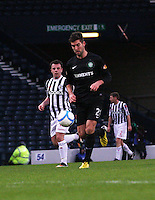 Charlie Mulgrew plays the ball back watched by Paul McGowanin the St Mirren v Celtic Scottish Communities League Cup Semi Final match played at Hampden Park, Glasgow on 27.1.13.