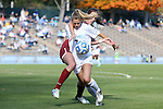 03 November 2013: North Carolina's Kealia Ohai (7) is defended by Boston College's Zoe Lombard (behind). The University of North Carolina Tar Heels hosted the Boston College Eagles at Fetzer Field in Chapel Hill, NC in a 2013 NCAA Division I Women's Soccer match and the quarterfinals of the Atlantic Coast Conference tournament. North Carolina won the game 1-0.