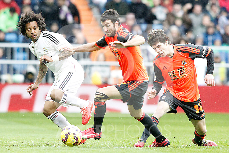 Real Madrid's Marcelo Vieira (l) and Real Sociedad's Imanol Agirretxe (c) and Aritz Elustondo during La Liga match.January 31,2015. (ALTERPHOTOS/Acero)
